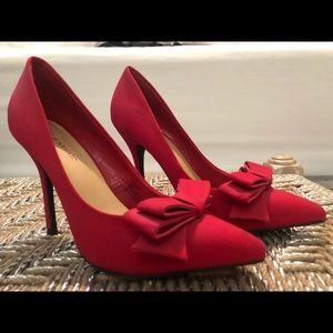 Vibrant red heels with bow